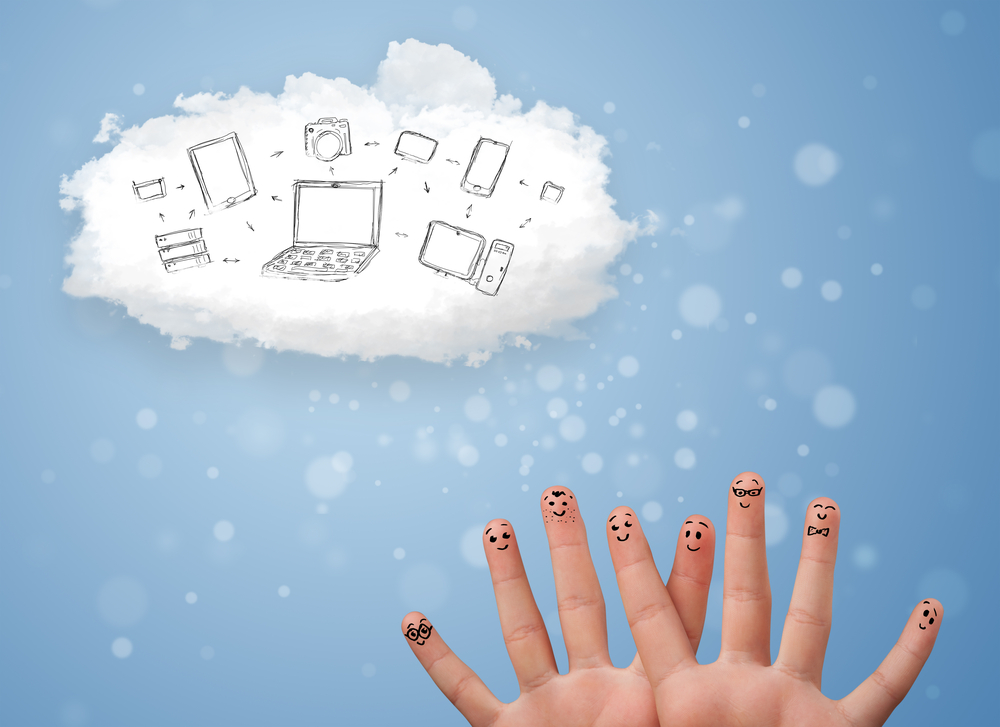 hands painted with smiley faces in the foreground over an illustrated background of internet devices floating in a cloud